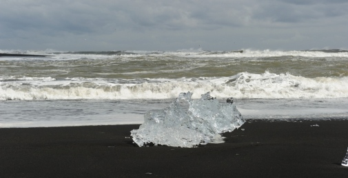 A block of ice on a black lava beach on Iceland